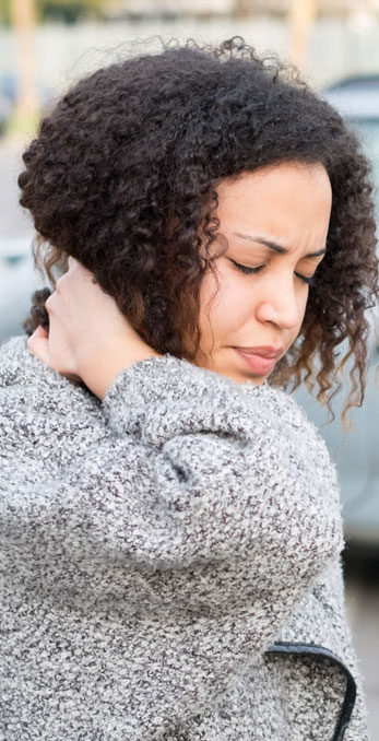 Woman Holding Her Neck In Pain